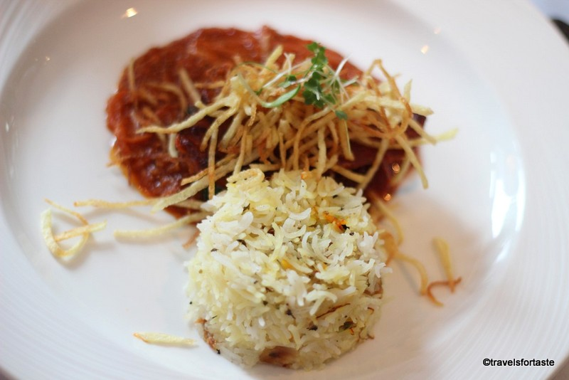Slow braised leg of kentish lamb 'salli' with straw potatoes and biryani rice at Shampan - the Spinning wheel
